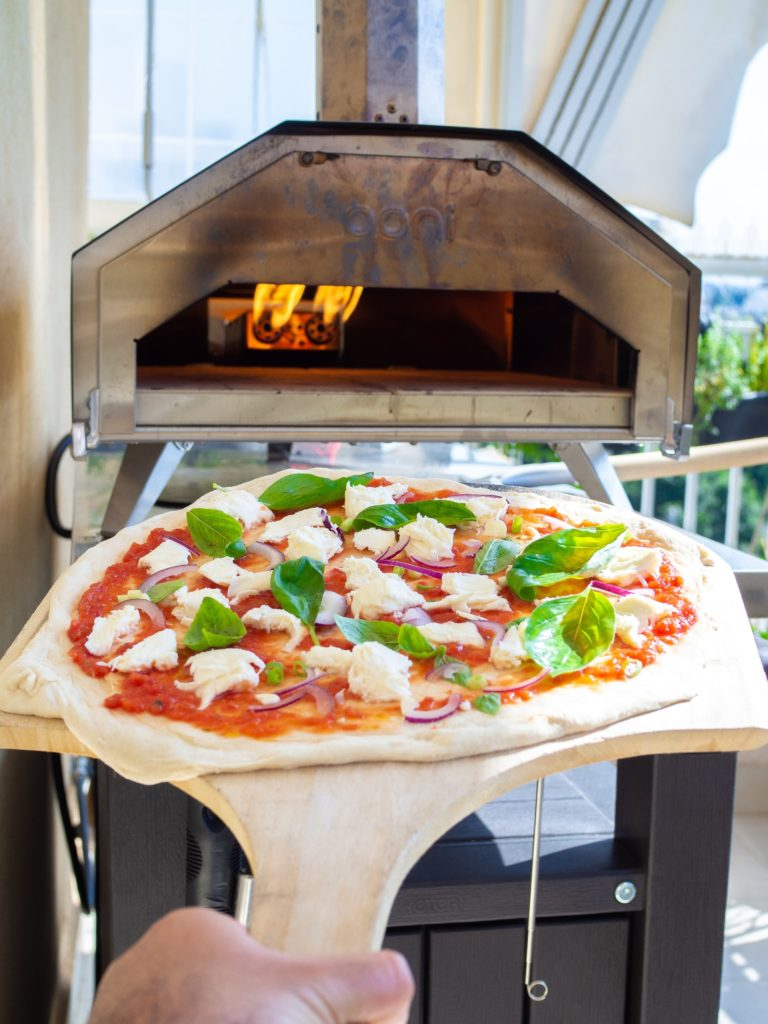 pizza in wood-fired pizza oven